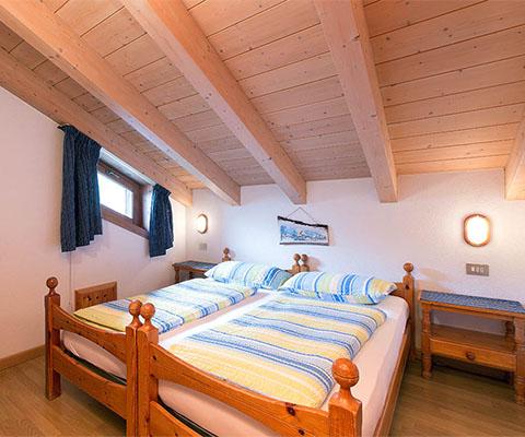 Camera in legno appartamento vacanze Livigno